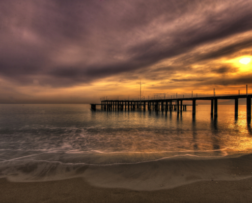 Canva – Wooden Pier at Sunset