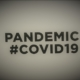 Canva – People Holding A Placard With Pandemic Covid19 Text