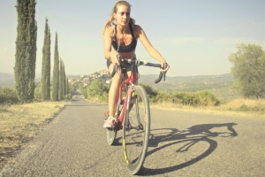 Canva – Woman in Black Tank Top Riding on Bicycle on Road (2)