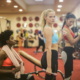 Canva – Women in Sports Bra and Black Leggings While Doing Exercise